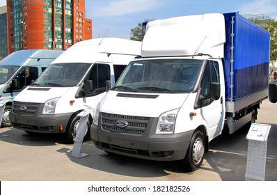 UFA, RUSSIA - MAY 15, 2012: Two light cargo vans Ford Transit at the city street.
