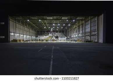 Ufa, Russia. May 19, 2018: Airport of Ufa. Aviation hangar with standing passenger planes. Front view