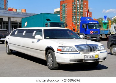 UFA, RUSSIA - MAY 22, 2012: White limousine Lincoln Town Car at the city street.