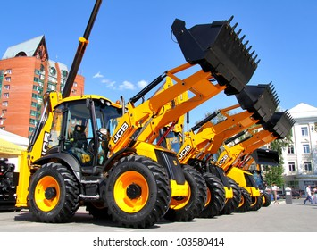 """UFA, RUSSIA - MAY 22: Line of JCB machinery at the annual International exhibition """"Gas. Oil. Technologies"""" on May 22, 2012 in Ufa, Bashkortostan, Russia."""