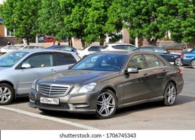 Ufa, Russia - May 25, 2012: Luxury motor car Mercedes-Benz E200 (W212) in the city street.