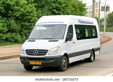 UFA, RUSSIA - MAY 28, 2008: White Mercedes-Benz Sprinter 515CDI interurban coach at the city street.