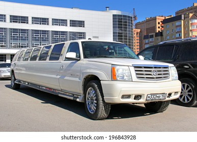 UFA, RUSSIA - MAY 28, 2014: White Cadillac Escalade limousine at the city street.
