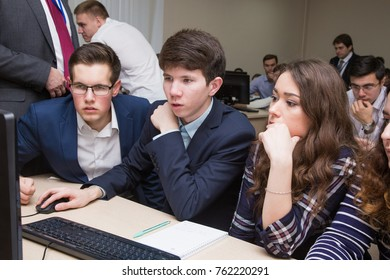 Ufa, Russia November 13, 2017: online financial strategy game VINK at the Oil University. students work together on a computer in a modern classroom