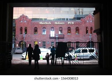 Ufa, Russia - November 16 2019: Sherlock Holmes pub and the tunnel - entrance to the art square in Ufa. Art kvadrat