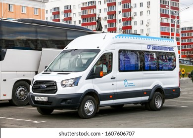 Ufa, Russia - October 10, 2019: White passenger van Ford Transit in the city street.