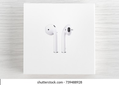 UFA, RUSSIA - OCTOBER 18, 2017: AirPods wireless headphones developed by Apple Inc. AirPods is on the box.