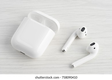 UFA, RUSSIA - OCTOBER 20, 2017: AirPods wireless bluetooth headphones developed by Apple Inc. Apple Airpods in open box.