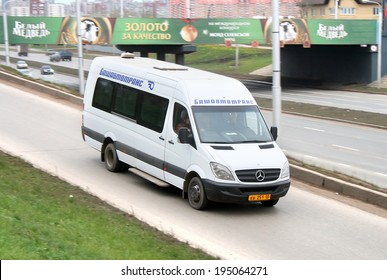 UFA, RUSSIA - OCTOBER 23, 2008: White Mercedes-Benz Sprinter 515CDI interurban coach at the city street.