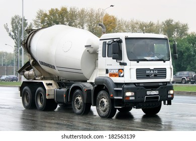 UFA, RUSSIA - SEPTEMBER 9, 2008: White MAN TGA concrete mixer truck at the city street.