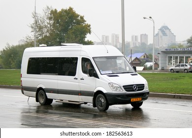 UFA, RUSSIA - SEPTEMBER 9, 2008: White Mercedes-Benz Sprinter 515CDI interurban bus at the city street.
