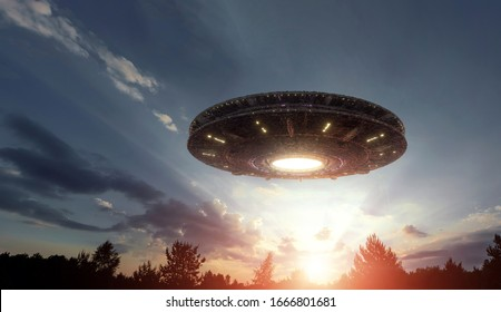 UFO, an alien plate hovering over the field, hovering motionless in the air. Unidentified flying object, alien invasion, extraterrestrial life, space travel, humanoid spaceship mixed medium - Shutterstock ID 1666801681