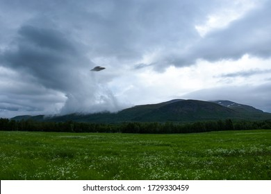 UFO over Khibiny Mountains on the Kola Peninsula in Russia. Flying saucer UFO is landing in the Khibins near Kirovsk city, Murmansk Oblast
