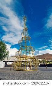 UGA, LANZAROTE, LAS PALMAS, SPAIN - January 17, 2019: Traditional Christmas tree against blue sky.