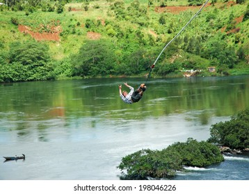 UGANDA, AFRICA - CIRCA MAY 2005: Unidentified man bungee jumping over the Nile River circa May 2005 in Uganda, Africa. Over four thousand miles in length, the Nile is the longest river on earth.