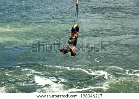 UGANDA, AFRICA - CIRCA MAY 2005: Unidentified couple bungee jumping over the Nile River circa May 2005 in Uganda, Africa. Over four thousand miles in length, the Nile is the longest river on earth.