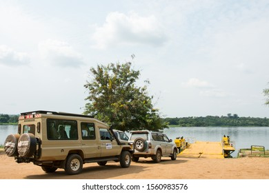 UGANDA, AFRICA – JUNE 17, 2019: Toyota Landrover uses the ferry to cross the Nile River to Murchinson Falls National Park, Uganda, Africa.