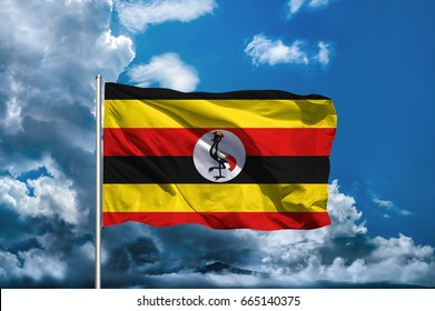 Uganda flag with sky background