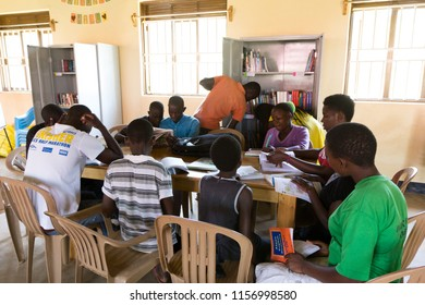 Uganda. June 28 2017. Young people and children reading books at a community library.