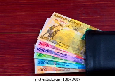 Ugandan Shilling in the black wallet