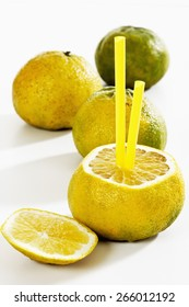 Ugli Fruits Sliced With Drinking Straws