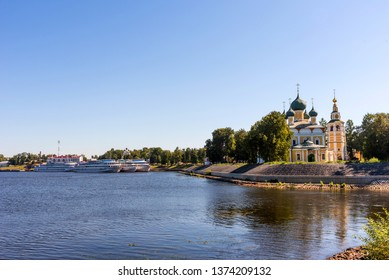 Uglich, Russia - August 11, 2018 : Panoramic view of cruise ships at Uglich pier on a sunny summer day. The Transfiguration Cathedral of the Kremlin in Uglich, Russia Golden Ring of Russia .