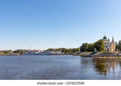 Uglich, Russia - August 11, 2018 : Panoramic view of cruise ships at Uglich pier on a sunny summer day. The Transfiguration Cathedral of the Kremlin in Uglich.  Golden Ring of Russia .