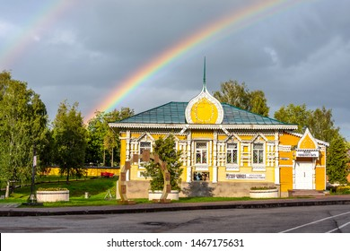 """Uglich, Russia - July 30, 2019. The building of the Museum of Urban Life. The inscription in Russian: """"Merchant's house of the 19th century. Museum of urban life. Museum-tea room""""."""
