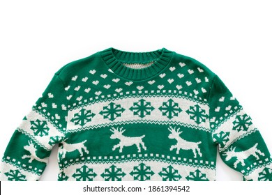 Ugly Christmas sweater concept. Festive jumper with deer and snowflake patterns isolated on white. Close up, top view, flat lay, copy space, background.
