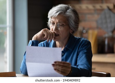 Ugly news. Distressed old age hispanic female check documents at home office read debt bankruptcy information in financial report. Upset stressed older latin woman get bad surprise in official letter