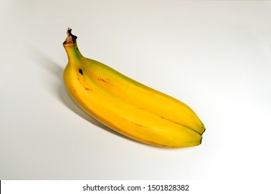 Ugly and odd shaped banana on white background