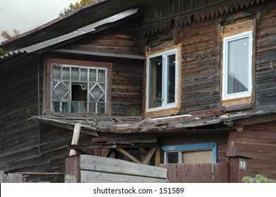 Ugly- renovated windors on old, wooden house