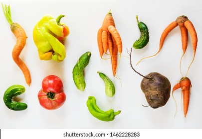 Ugly vegetables on a white background. Ugly food concept, flat lay.