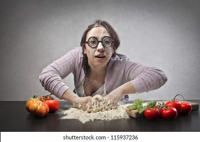 Ugly woman making a pizza