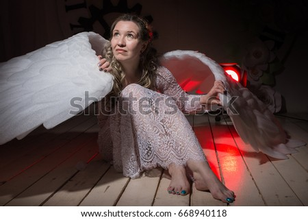 e0072f29a Ugly woman in a white dress with white wings is trying to look as angel