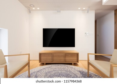 uhd 65 inch tv in a white indoor