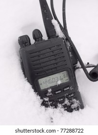 UHF 2way radio laying in the snow