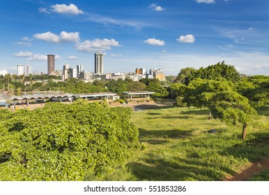 Uhuru Park in Nairobi, Kenya with the skyline in the background.