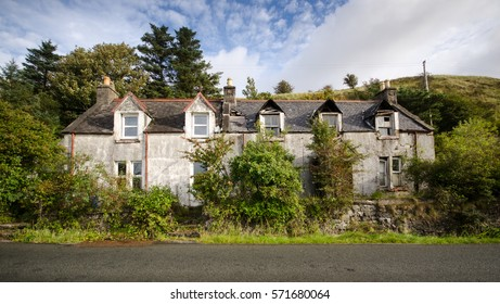 Uig, Scotland - September 20, 2009: A partially derelict and damaged house is overgrown with shrubs in the remote village of Uig on the Isle of Skye in the Highlands of Scotland.