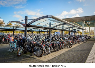 UITGEEST, THE NETHERLANDS - NOVEMBER 2, 2017: Massive pile of bikes / bicycles parked & locked at Uitgeest train station. Being the main transportation, bikes' huge parking is common in Netherlands.