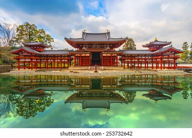 Uji, Kyoto, Japan - famous Byodo-in Buddhist temple, a UNESCO World Heritage Site. Front of the Byodo-In Temple on a cloudy morning.