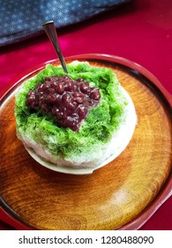 Ujikintoki Kakigori - Traditional Japanese dessert at Kiyomizu-dera temple in Kyoto, Japan. Shaved ice, matcha green tea and red beans.
