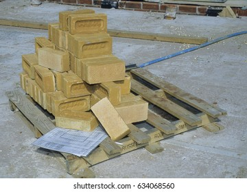 UK Bedfordshire Clapham 2001. New housing estate in the process of being built for public sale. Builders materials. Pallet of red house bricks. Builders house drawings. Building plans.