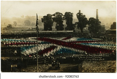 UK - CIRCA 1912: Reproduction of antique postcard shows Bristol Empire Day Celebration, 2500 school children form Living Union Jack, UK, 1912