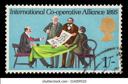 UK - CIRCA 1970: Commemorative mail stamp printed in the UK featuring the signing of the International Co-operative Alliance, circa 1970