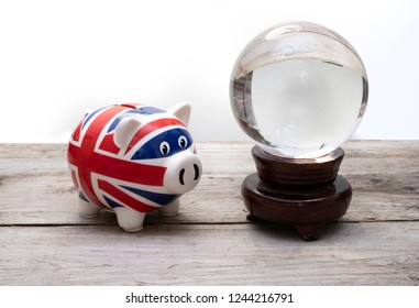 UK economy prediction, union jack piggy bank with crystal ball