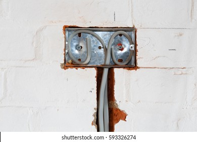 UK Electrical installation of a socket into a wall of a house