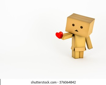 UK - February 2016: Cute Danbo character lovingly holds out a red heart.