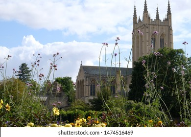 UK historic stone cathedral building set in a background of gardens. Architectural craftsmanship in Britain of stonemason in the County of Suffolk. Bury St Edmunds.