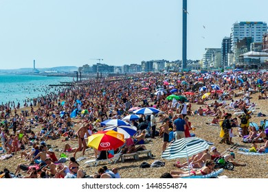 UK June 29th, 2019 Brighton beach, Brighton and Hove, East Sussex, England. Thousands of people relax in the sun.
